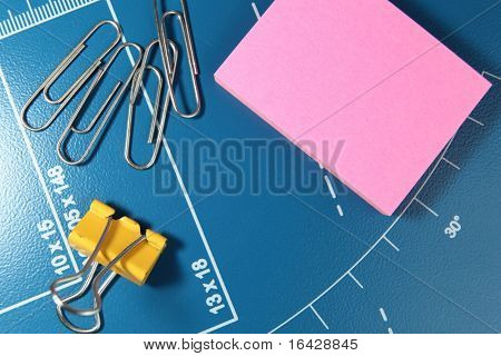 office stationery - paper clips and post-it pink note paper - space for your text available on the pink note paper - can be used as a background as well
