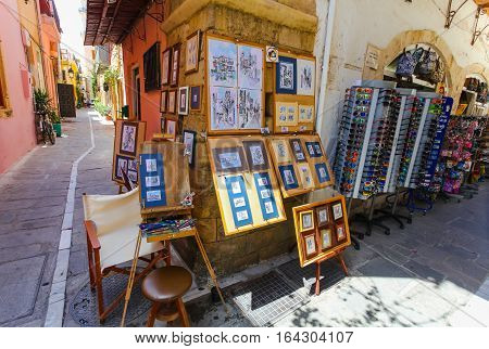 Rethymnon, Island Crete, Greece - July 1 2016: The narrow streets of Rethymnon (part of Old Town) where tourists are walking and buying souvenirs