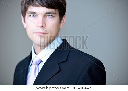 Portrait of a young handsome confident businessman