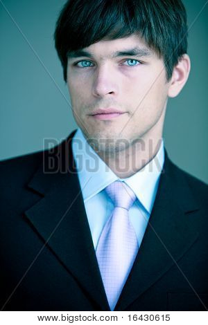 Close-up portrait of a young handsome confident businessman/lawyer