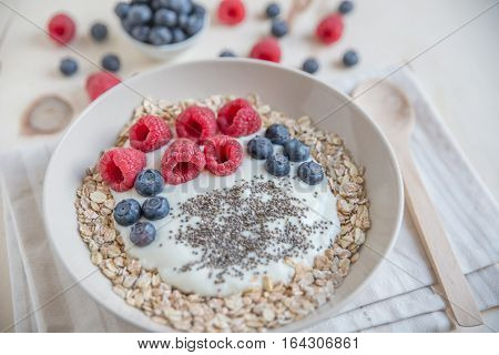 Yogurt with fresh berries and granola in a bowl