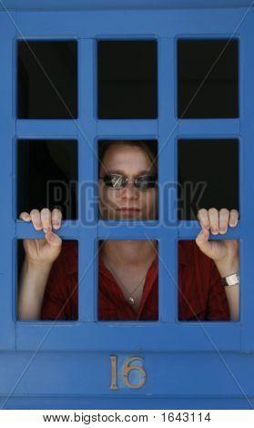 Man Watching Through Bars
