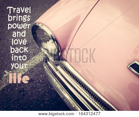 Inspirational quote on pink vintage car background.