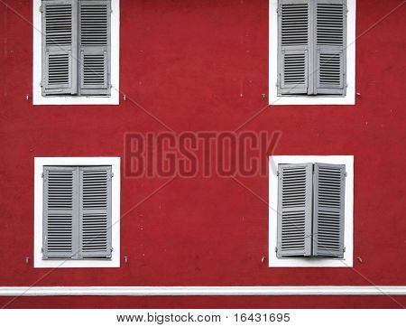 red house facade with white windows (Corte, Corsica, France)