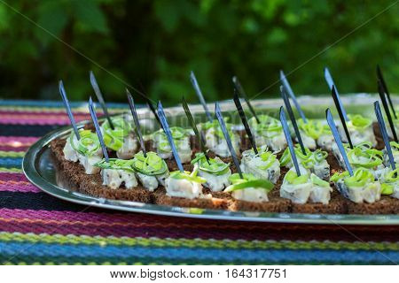 Sandwiches with herring and leek. The concept of food and catering.