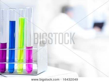 scientific research concept - in the lab (shallow depth of field; focus on the test tubes; color toned image)