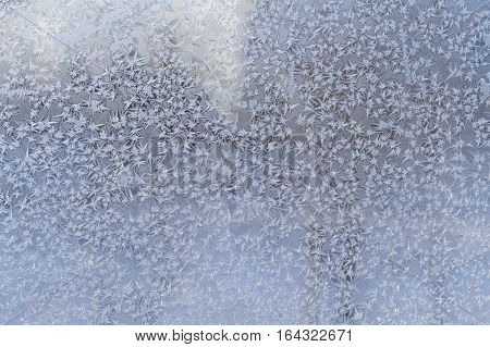 in the photo beautiful ice patterns on winter glass
