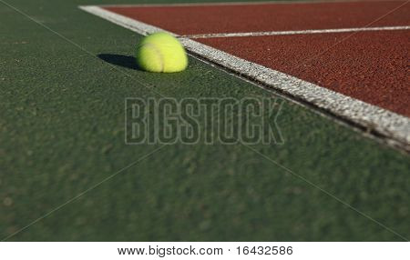 The impact - Tennis ball bouncing off the tennis court