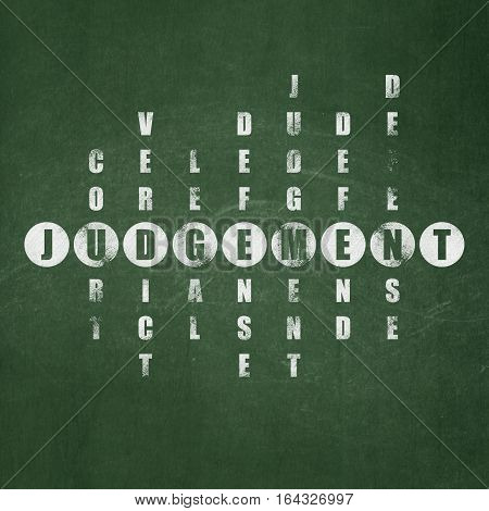 Law concept: Painted White word Judgement in solving Crossword Puzzle on School board background, School Board