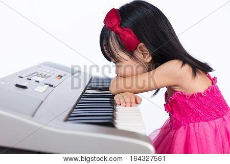 Boring Asian Chinese Little Girl Playing Electric Piano Keyboard