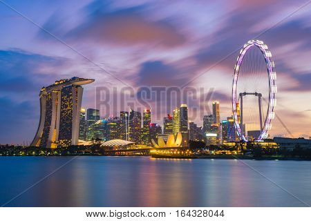 Landscape of the Singapore landmark financial district at twilight sunset scene with blue sky and clouds. Singapore downtown