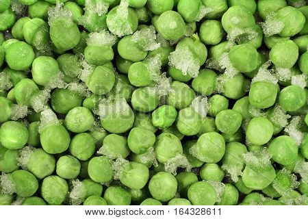 Close-up of frozen green peas with ice crystals. Food background
