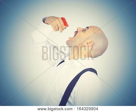 Man using breath freshener . Sprayer trigger.