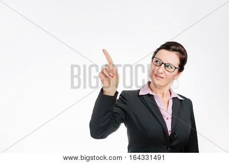 Cheerful businesswoman pointing at copy space isolated on white background