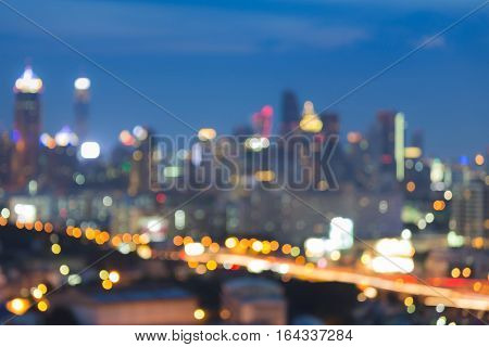 Blurred bokeh lights city and road night view with twilight sky background