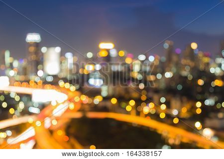 Night blurred lights city central business downtown and highway intersection abstract background