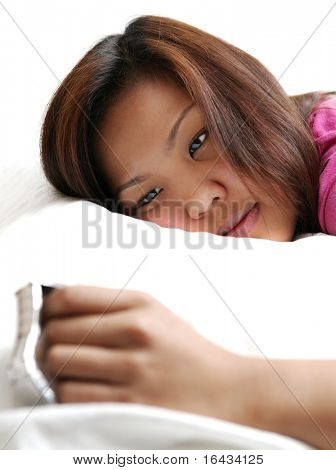 Insommnia - young asian woman looking at her watch, unable to fall asleep