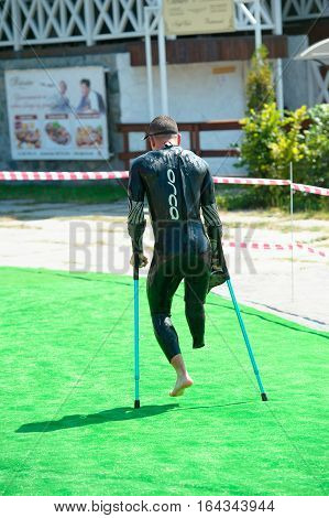 Triathlon Cup of Ukraine and Cup of Bila Tserkva. July 24 2016 in Bila Tserkva Ukraine. Paralympic athlete disabled man running on the contest