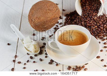 Coffee Beans And Coconut On White Table