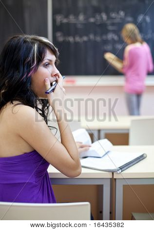 pretty female college student in a classroom - really bored during class