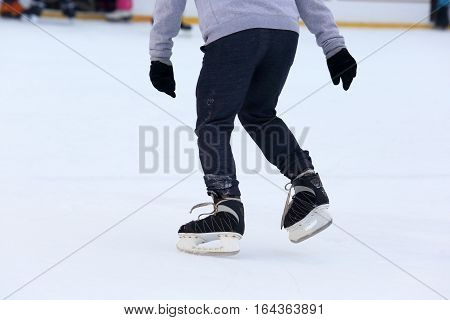 the man skating on an ice rink