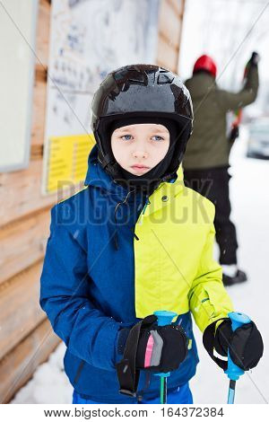 Child Preparing For Skiing.