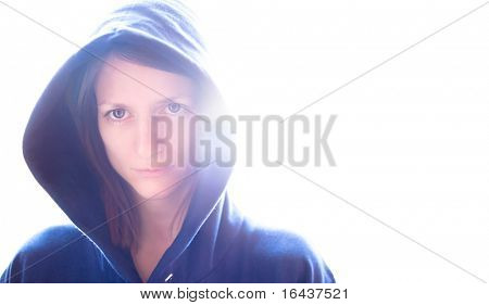 portrait of a pretty young woman wearing a blue hoodie on glowing background