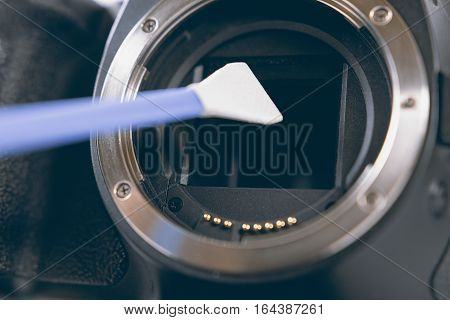 Digital Photo Camera With Cleaning Tools. Cleaning Dirty Camera Sensor.