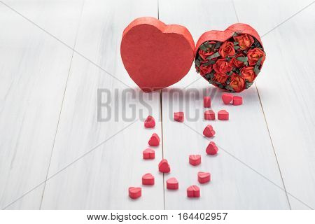 Heart Shape Box With Red Roses Inside And Mini Heart On White Wood Table Top ,love Concept,valentine