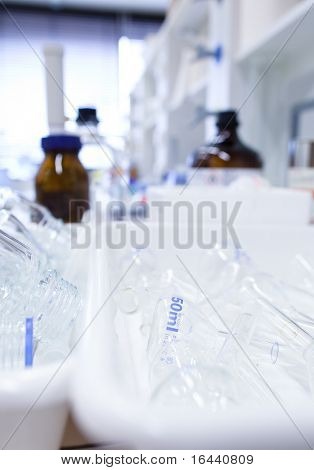 chemistry lab (shallow DOF; focus on the glassware in the foreground)