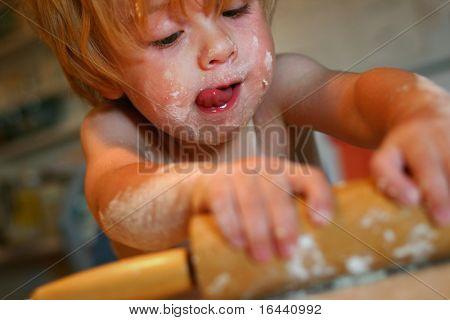 toddler helping in kitchen