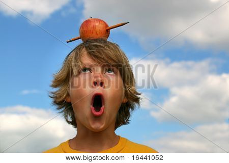 boy surprised by pencil shooting through apple, (symbolic  for, Back to School)