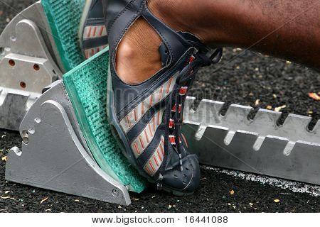 runner in blocks at track meet