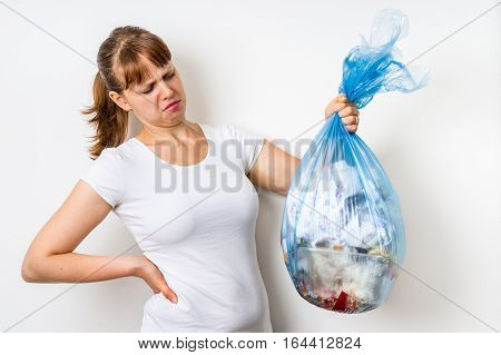 Woman Holding A Smelly Garbage Bag