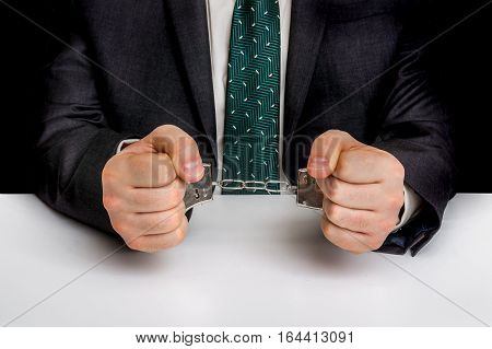 Arrested Man In Black Suit With Handcuffs