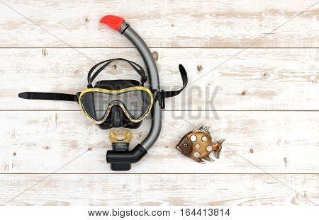 Scuba diving and snorkelling. Diving mask and snorkel on wood background