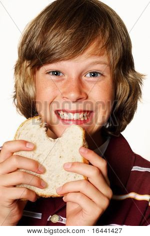 Happy boy eating a sandwich