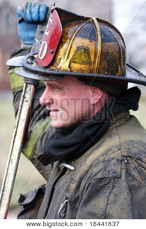 Firefighter resting after fighting a house fire