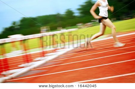 Running in a hurdle race (motion blur)