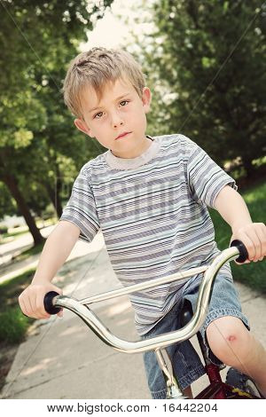 Boy on a bike with a scraped knee