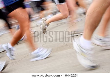Marathon runners (in camera motion blur)