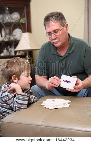 Father and son studying flash cards