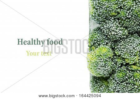 Border of fresh frozen green broccoli with hoarfrost closeup on white background. Isolated. Healthy vitamin food.