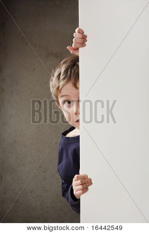 Boy Peeking around a wall