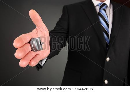 Closeup of a hand with a hand buzzer, reaching to shake hands.