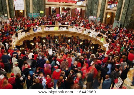 MADISON, WI - FEB 17: Thousands fill the capitol protesting Wisconsin Gov Scott Walker's proposal to eliminate collective bargaining rights for public workers on Feb 17, 2011 in Madison Wisconsin.