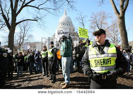 MADISON, WI-FEB 19:Deputies with the Dane County Sheriff Dept stood guard at a rally organized by the Tea Party on February 19, 2011 in Madison, Wisconsin.