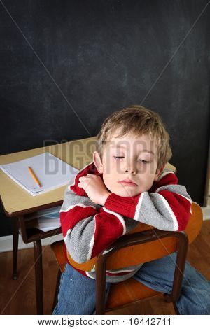 Frustrated student laying his head on his arms