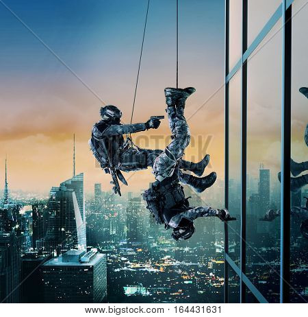 Special forces police swat operators assault rappeling with weapons. High-rise building skyscraper. Hostage rescue concept