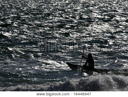 Silhouette of a kayaker in the surf at Adelaide;s Glenelg Beach